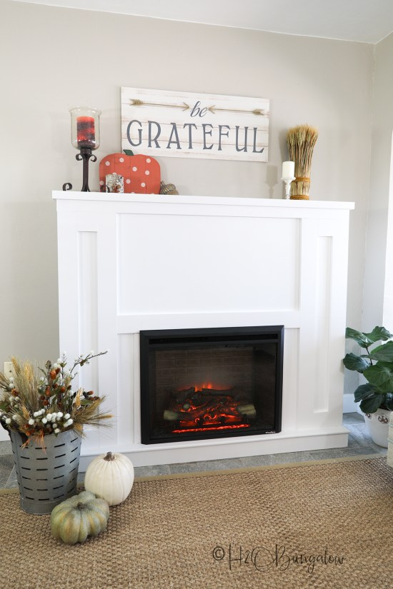 Tutorial to build a DIY fireplace with an electric insert. Plans, a video and written instructions