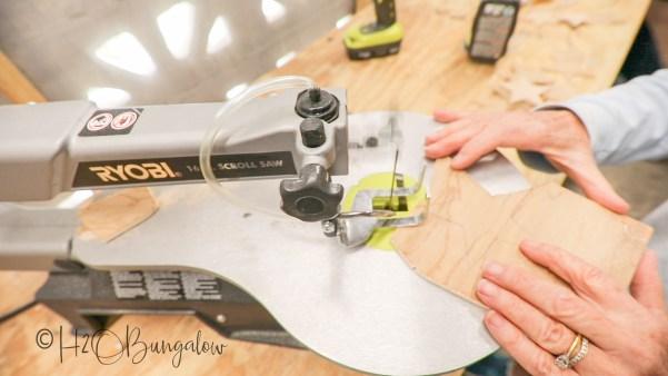 cutting-wood-stars-for-DIY-rustic-garland
