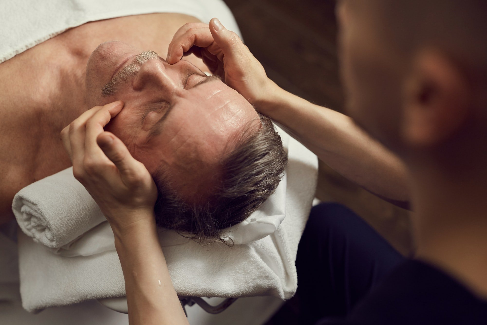 Mature Man Enjoying Facial Massage in SPA