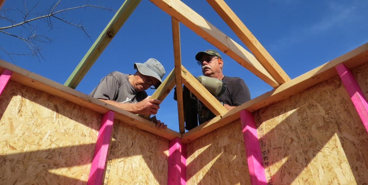 volunteer to build a home for a family stuck in poverty housing