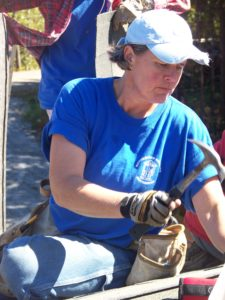 Lori Herrick wields a hammer for the Women Roofers