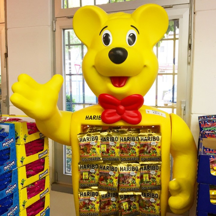 The golden bear holding golden gummy bears greets you as you walk in!