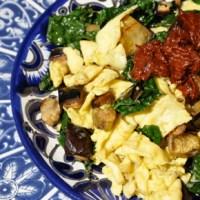 Harissa Egg Scramble with Kale & Roasted Eggplant