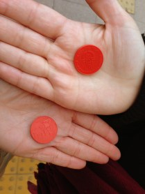 Plastic tokens for taking the bus.