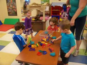 children playing with play doh