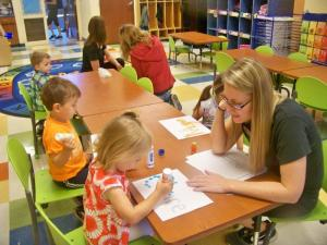 Children using dot paint