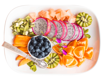 plate with assortment of sliced fruit