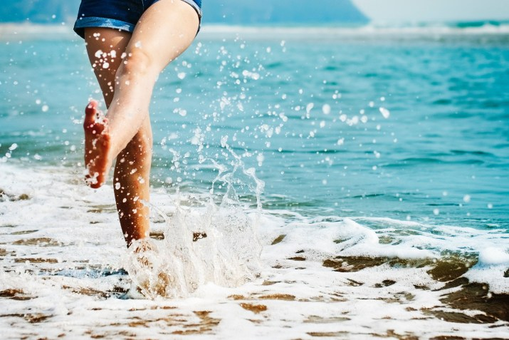 barefoot-beach-splashing-water.jpg