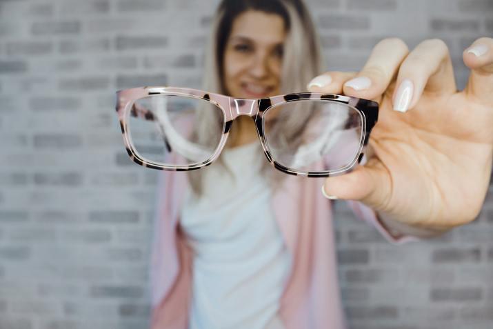 woman holding glasses.jpeg