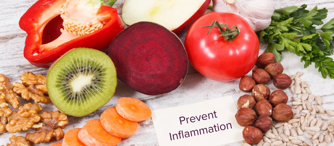 healthy foods with sign about preventing inflammation