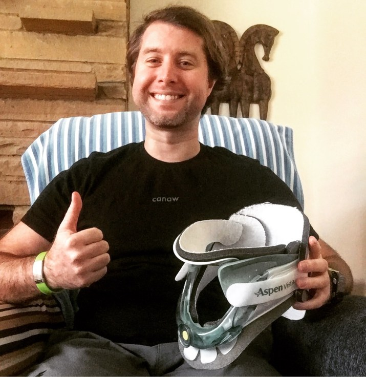 Graham giving a thumbs-up, posing with neck-brace in hand