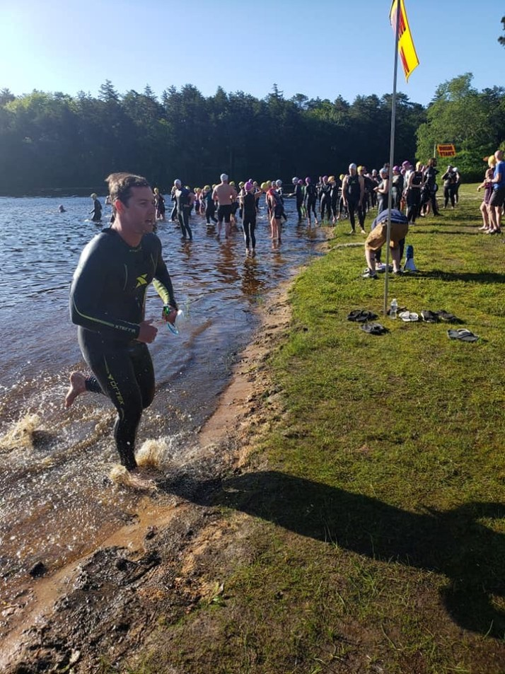 Graham charging out of the water at a triathlon event