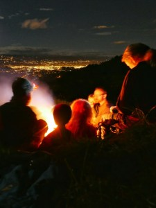 Campfire at night, overlooking the lights of Cuenca, Ecuador
