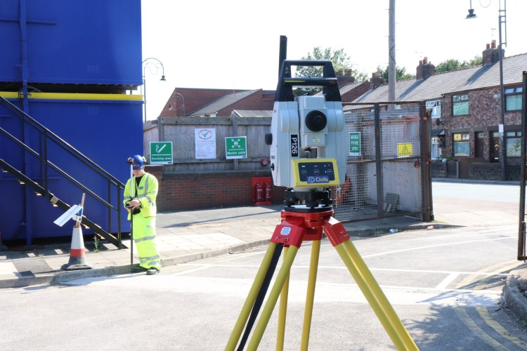 Elliot using the theodolite