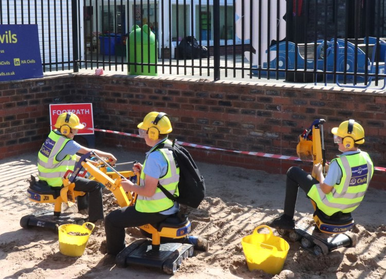 St Sebastian's pupils on mini diggers