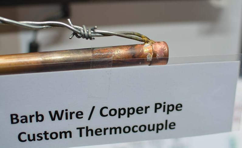 Barbed wire copper pipe thermocouple. Those are just brazed together.
