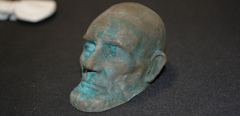 Lincoln death mask in bronzefill. Patinaed with vinegar.
