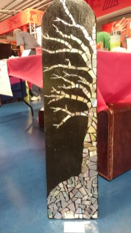 Tiled mosaic tree made from CDs.