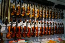 Wall of violins at one of the stringed instrument stores