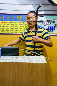 Shop owner playing his erhu in his free time when no customers are around