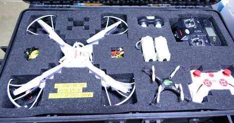 A few Sima drones with case, $200