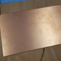 Copper clad secured to wood