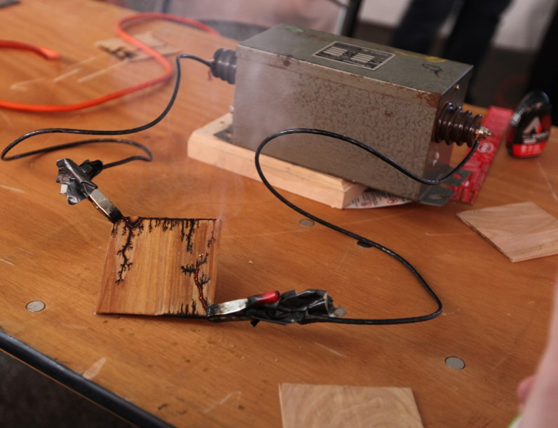 Making Lichtenberg figures in a piece of wood with a transformer