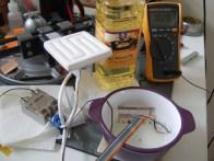 Cracked ramekin, leaking hot oil, collecting data.