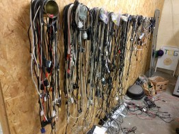 Tin cans on the wall for cable storage