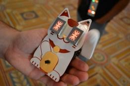 28-cat-badge-waving