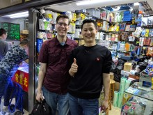 Mike and Xuan pose beside the Xuan Hoa booth in Shenzhen, China