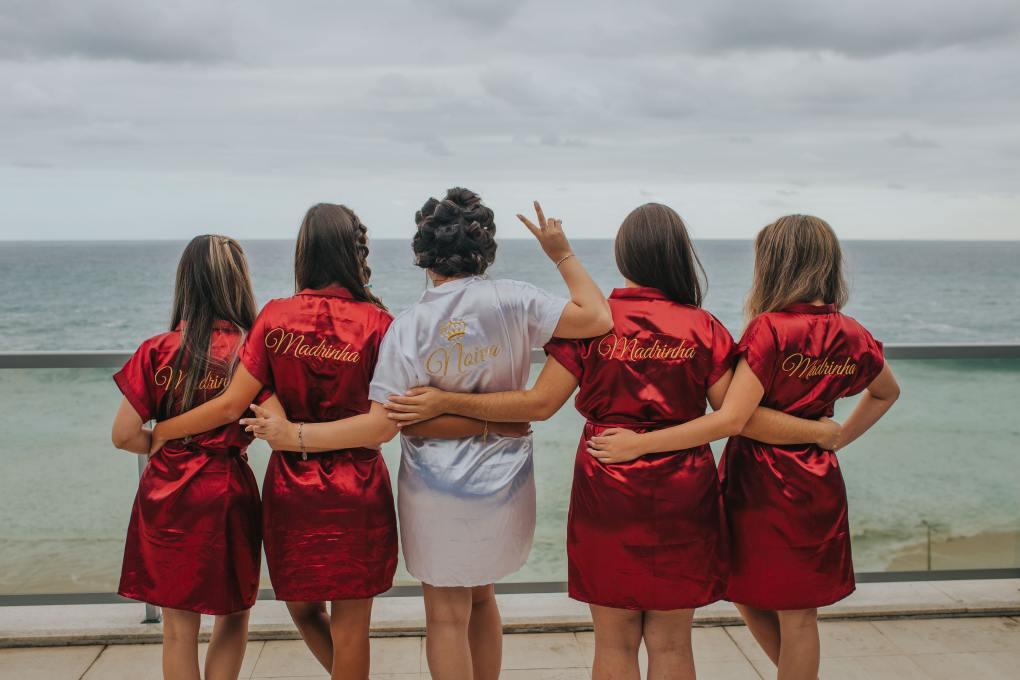 brides and bridesmaid looking at the back