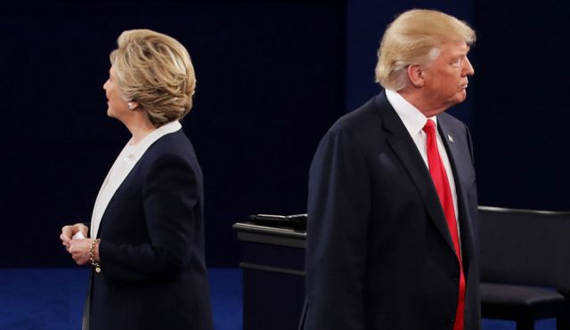 ST LOUIS, MO - OCTOBER 09: Democratic presidential nominee former Secretary of State Hillary Clinton (L) and Republican presidential nominee Donald Trump listen during the town hall debate at Washington University on October 9, 2016 in St Louis, Missouri. This is the second of three presidential debates scheduled prior to the November 8th election. (Photo by Chip Somodevilla/Getty Images)
