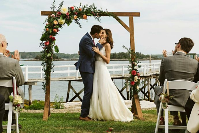 First kiss at Boothbay Harbor Maine Wedding