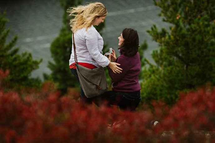 A woman proposes to her girlfriend on a mountain in Acadia National Park
