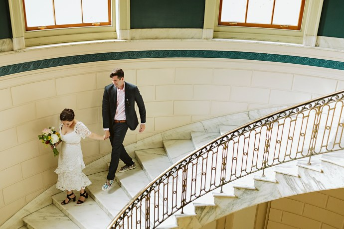 couple exiting city hall after Portland Maine elopement