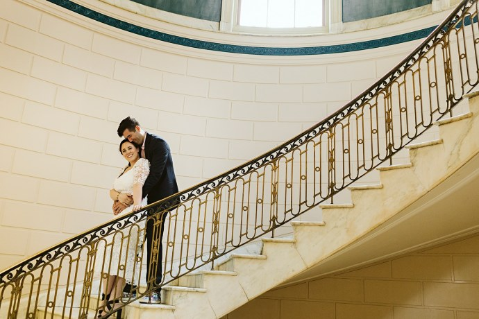 Bride and groom on stairs at city hall during Portland Maine elopement