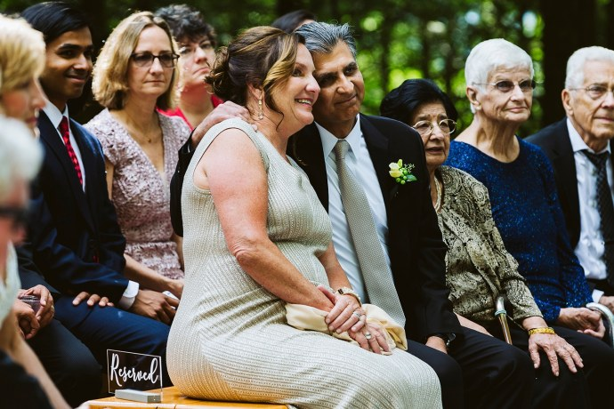 bride's parents smile during ceremony