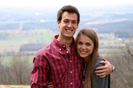 Newly engaged and posing in front of the overlook.