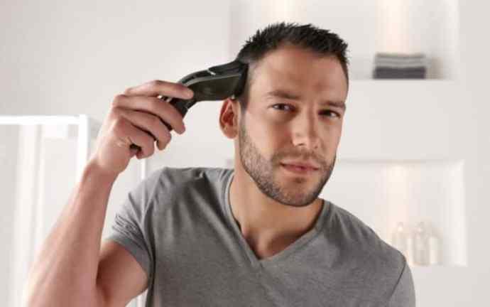 Manu using a cordless hair clipper