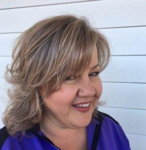 Wavy Shoulder-Length With Bangs Haircut