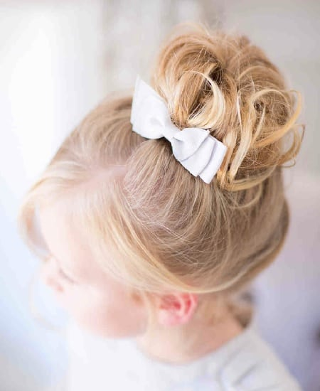wedding hairstyle with bun for little girl