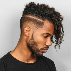 16 Must-Try Hairstyles For Black Men | Asymmetrical Cut with a Hard Part | Hairstyleonpoint.com