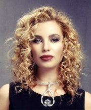 medium curly golden blonde hairstyle