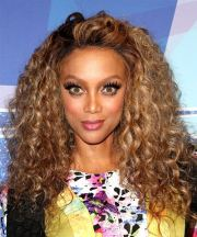 tyra banks long curly casual hairstyle