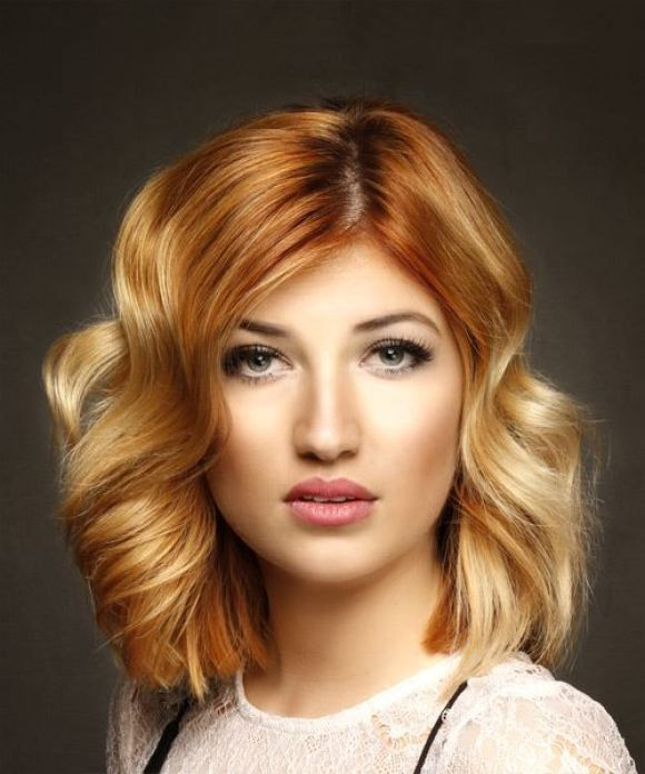 Wavy copper red bob with blonde bayalage highlights