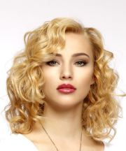 medium curly light golden blonde