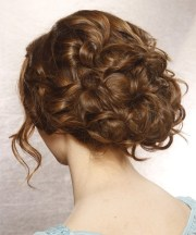 long curly brunette updo with side
