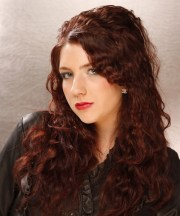 long curly dark auburn red hairstyle