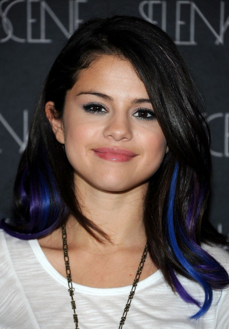 Hairstyle with vibrant blue and violet streaks